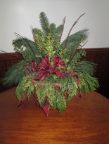 Indoor or outdoor evergreen arrangment